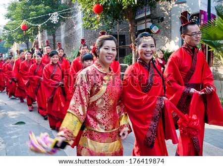 FOSHAN, CHINA - JUNE 5:The women's Federation held in the ancient temples of traditional collective wedding ceremony, 30 couples participated, including parade and celebration Jun 5, 2014 in Foshan, China - stock photo