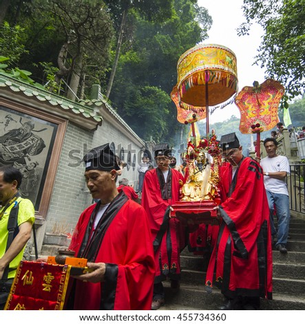 FOSHAN, CHINA - May 20, 2016:Taoist god's birthday, believers dressed in traditional costumes, carried the gods, to travel on the road, activity attracted many people to watch. - stock photo