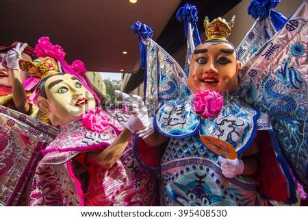 FOSHAN,CHINA - November 25, 2015: Taiwan Electronic Music three prince group visit foshan and lion dancing together, Electronic Music three prince is the traditional culture of Taiwan.Editorial Image. - stock photo