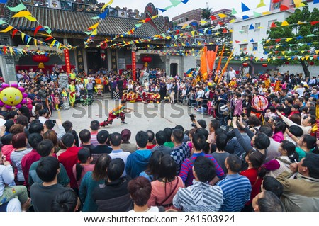 FOSHAN Feb 27:Chinese New Year, Chinese people will be in the ancestral temple worship of ancestors, a teenager in martial arts, this is a traditional custom Feb 27, 2015 in Foshan, China - stock photo