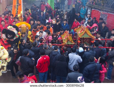 FOSHAN-Feb 17:Lantern Festival is the birthday of pond his village temple god, villagers carried the god, cruise, lion dance and setting off firecrackers, very busy Feb 17, 2011 in Foshan, China - stock photo