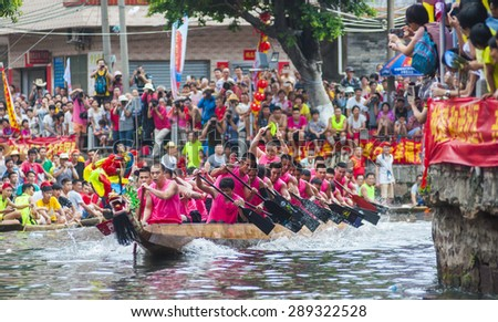 FOSHAN-June 21:The Dragon Boat Festival dragon boat in Fen rivers, there are 17 dragon boat teams took part in the game, attracted tens of thousands of people watched June 21, 2015 in Foshan, China - stock photo
