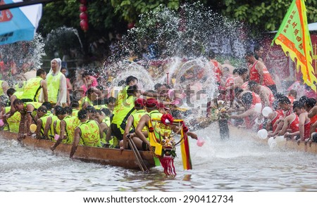 FOSHAN-June 23:The Dragon Boat Festival dragon boat race, the athletes on the river water play each other, having a great time June 23, 2015 in Foshan, China - stock photo