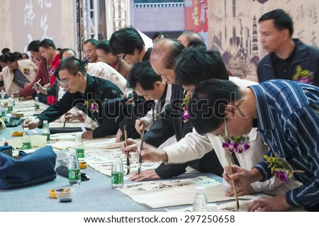 FOSHAN Oct 27:In order to carry forward the culture, calligraphy competition held in foshan, 300 people to write Chinese calligraphy competition in Oriental plaza Oct 27, 2010 in Foshan, China - stock photo