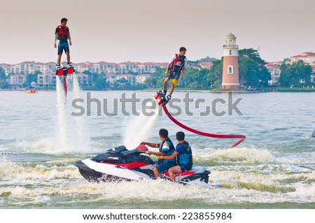 FOSHAN - Sep 29:In order to celebrate the arrival of the National Day, water stunt team in foshan lake show, great reversal movement attracted thousands of people watched Sep 29, 2014 in Foshan, China - stock photo