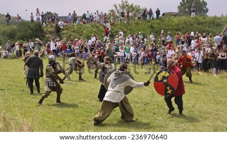 FOTEVIKEN, SWEDEN - JULY 03, 2011: Vikings in a battle on a Viking camp in Foteviken Sweden, July 03 2011. Here was vikings from the whole north Europe, even from east.