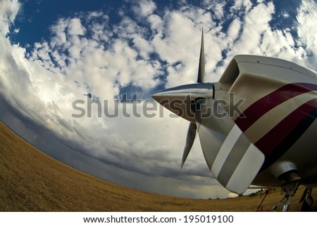 foto of an small airplane on green grass and sunset background  - stock photo