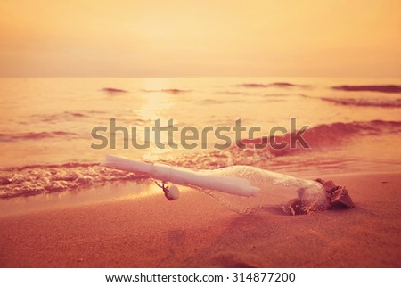 Found message in a bottle - stock photo