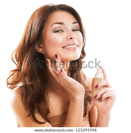 Foundation. Beauty Girl Putting on Makeup. Beautiful Woman Applying Make-up - stock photo