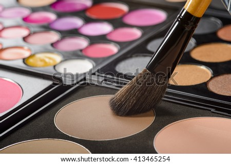 Foundation palette with flesh matte colors and Chinese brush in it. The process of applying the make-up. Big set of the beauty salons' equipment. - stock photo