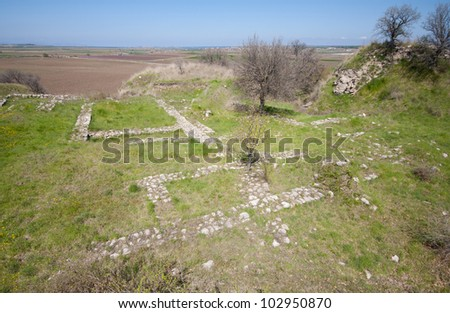 Foundations  of a  temple in  the ancient city of Troy (3000BC - 1BC) with ruins of twelve cities built on top of each other (Troy I to Troy XII), in Anatolia, Turkey. - stock photo