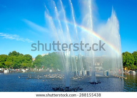 Fountain and beautiful rainbow in Gorky Park. Moscow. Russia - stock photo