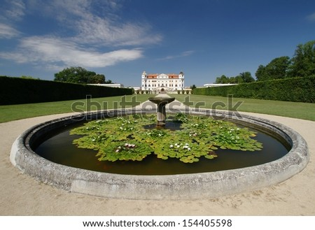 Fountain and castle - stock photo