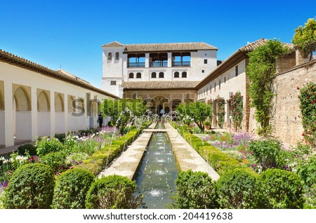 Fountain and gardens in Alhambra palace, Granada, Andalusia, Spain. - stock photo
