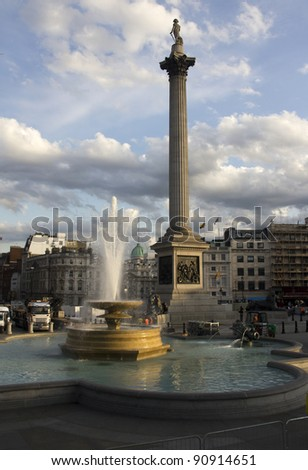 Fountain and Nelson's column on Trafalgar Square in London, UK - stock photo