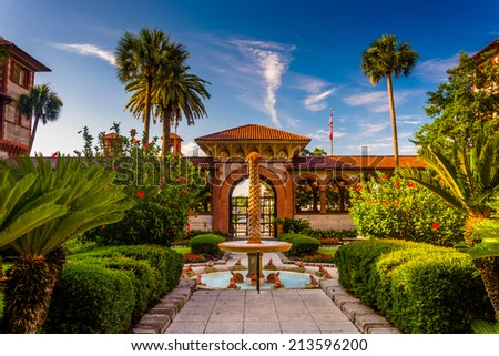 Fountain and palm trees at Flagler College, St. Augustine, Florida. - stock photo