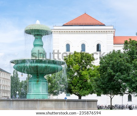 Fountain at the Ludwig Maximilian University of Munich. - stock photo
