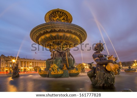 Fountain at the Place de la Concorde in Paris by night, France - stock photo
