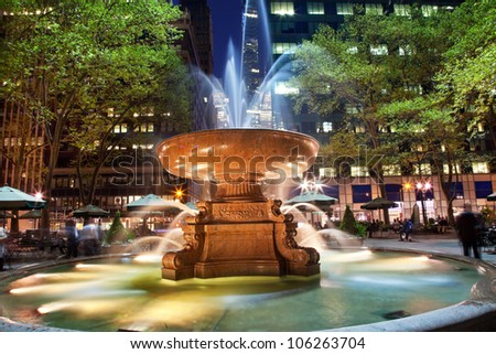 Fountain Bryant Park New York City Apartment Buildings Night Faces blurred trademarks removed - stock photo