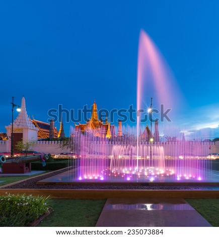 Fountain dance show in front of Wat Phra Kaew, Temple of the Emerald Buddha in Bangkok, Thailand  - stock photo