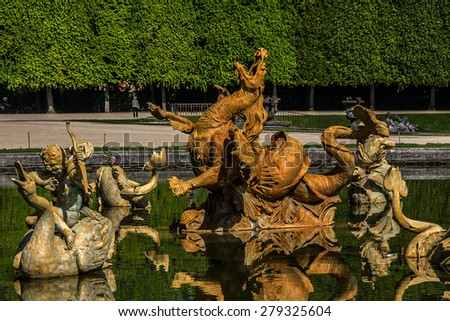Fountain in beautiful gardens of famous Versailles palace. The Palace of Versailles was a royal chateau. It was added to the UNESCO list of World Heritage Sites. Paris, France. - stock photo