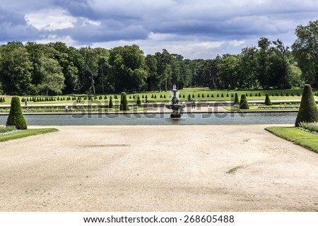 Fountain in Fontainebleau palace Park. Palace of Fontainebleau - one of largest Medieval royal chateaux in France (55 km from Paris), UNESCO World Heritage Site. - stock photo