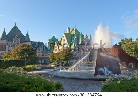 Fountain in front of historic building landmark of Gare du Palais railway station in Quebec City, Canada - stock photo