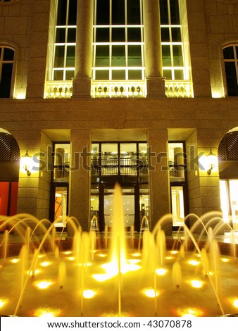 Fountain in front of shopping mall - stock photo