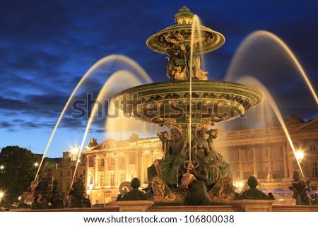 Fountain in Place de la Concorde at dusk, Paris, France - stock photo