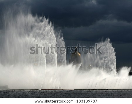 Fountain in St. Petersburg, rainbow, St. Isaac's Cathedral, clouds
