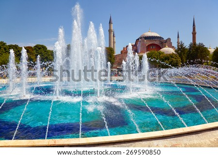 Fountain in Sultan Ahmet Park with Hagia Sophia in the background, Istanbul, Turkey - stock photo