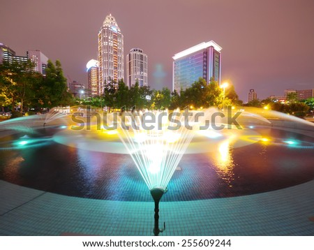 fountain in the park of city - stock photo
