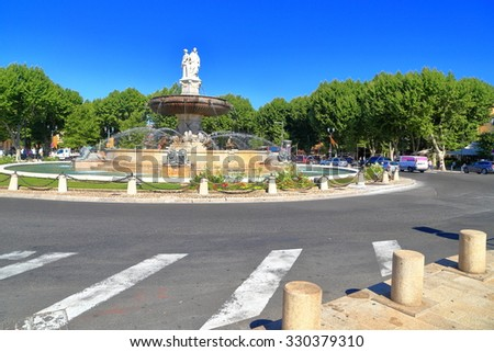 Fountain located on sunny square in Aix en Provence, Languedoc Roussillon, France