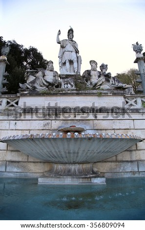 Fountain of  Dea di Roma with Tiber and Aniene, Piazza del Popolo in Roma, Italy ( photographed very early in the morning ) - stock photo