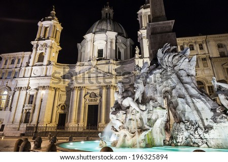 fountain of four rivers in Piazza Navona at night, Rome - stock photo