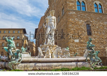 Fountain of Neptune surrounded by medieval buildings in Piazza della Signoria, Florence, region of Tuscany, Italy
