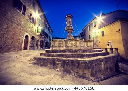 Fountain on Piazza del Grano, Asciano, Tuscany, Italy - stock photo