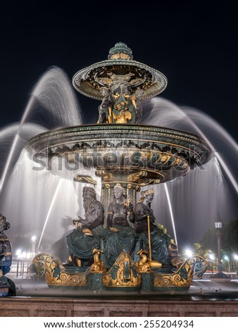 Fountain on Place de la Concorde illuminated at nighttime, Paris, France - stock photo