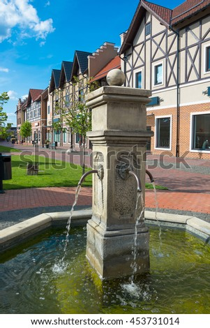 Fountain on the street of European town in the summer