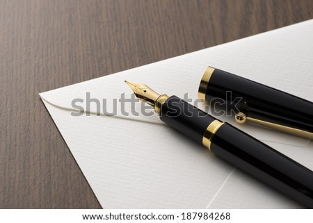 fountain pen and letter on table - stock photo