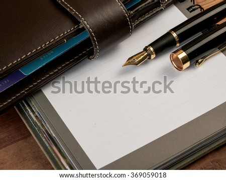 Fountain pen and notebook  - stock photo