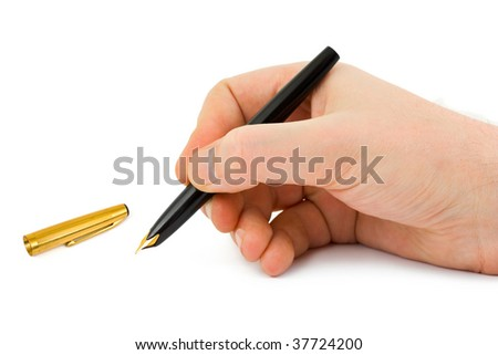 Fountain pen in hand isolated on white background