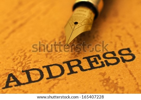 Fountain pen on address - stock photo