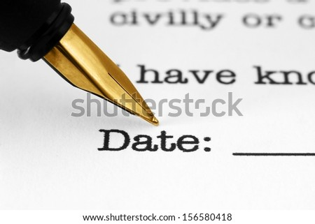 Fountain pen on agreement form - stock photo