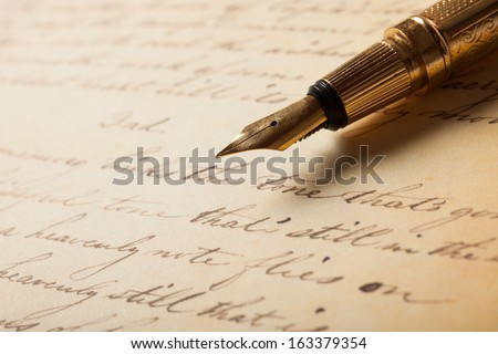 Fountain pen on an antique handwritten letter - stock photo