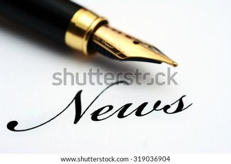 Fountain pen on news text - stock photo