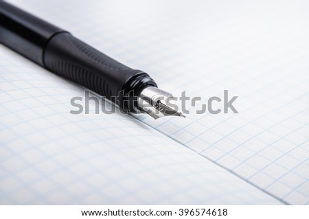 Fountain pen on notebook in a cage