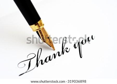 Fountain pen on thank you - stock photo