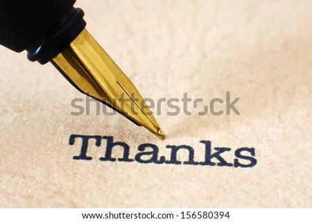 Fountain pen on thank you text - stock photo