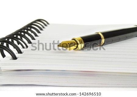 fountain pen on the notebook - stock photo